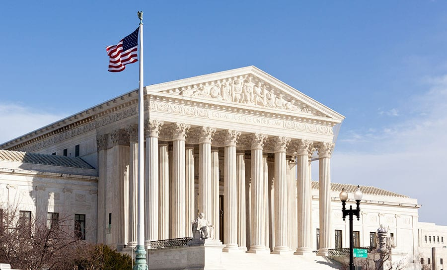 Facade of U.S. Supreme court in Washington DC on sunny day
